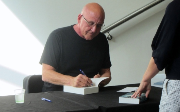 Michael Grant signing books following Auckland Writers Festival talk