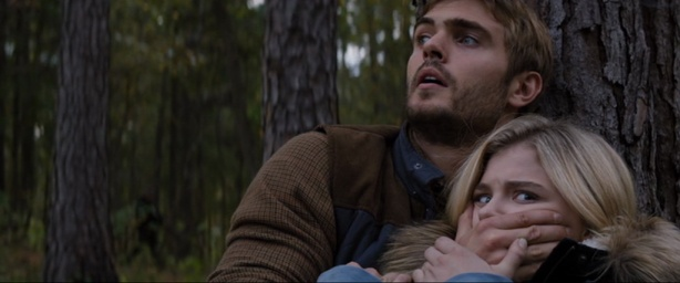Alex Roe as Evan and Chloë Grace Moretz as Cassie